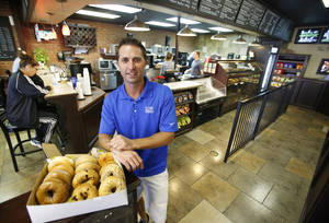 Photo - Wayne Hansen, co-owner of Old School Bagel Cafe at May and Hefner, saved his family $400 a month by rolling off his wife's employer-sponsored health insurance and turning to doctors in a new Oklahoma fee-for-service startup for his primary medical needs.  Photo by Steve Gooch, The Oklahoman