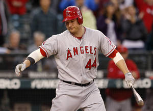 Photo -   Los Angeles Angels' Mark Trumbo strikes out swinging against the Seattle Mariners in the ninth inning to end a baseball game Wednesday, Oct. 3, 2012, in Seattle. The Mariners won 12-0. (AP Photo/Elaine Thompson)