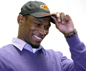 Photo - NATIONAL SIGNING DAY / SIGN: Joe Randle adjusts his cap after signing a letter of intent to attend Oklahoma State University (OSU) at Southeast High School in Wichita, Kansas on Wednesday, Feb. 3, 2010. Photo by John Clanton, The Oklahoman