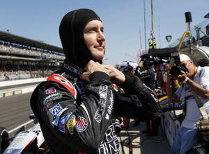 Photo - Kurt Busch prepares to drive on the final day of practice for the Indianapolis 500 IndyCar auto race at the Indianapolis Motor Speedway in Indianapolis, Friday, May 23, 2014. The 98th running of the Indianapolis 500 is Sunday. (AP Photo/Tom Strattman)