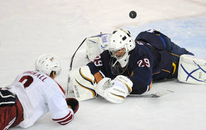 Photo - Phoenix Coyotes' Scottie Upshall, left, scores the tying goal against Edmonton Oilers' Martin Gerber during the third perioe an NHL preseason hockey game in Edmonton, Alberta, on Wednesday, Sept. 29, 2010. Edmonton won 4-3 in a shootout. (AP Photo/The Canadian Press, John Ulan)