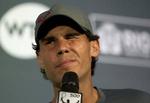 Photo - Rafael Nadal, of Spain, listens to a question at a press conference ahead of the Rio Open ATP in Rio de Janeiro, Brazil, Friday, Feb. 14, 2014. The Rio Open ATP tennis tournament starts Saturday. (AP Photo/Silvia Izquierdo)