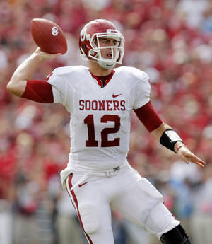 Photo - OU quarterback Landry Jones (12) passes the ball in the first half during the Red River Rivalry college football game between the University of Oklahoma Sooners (OU) and the University of Texas Longhorns (UT) at the Cotton Bowl in Dallas, Saturday, Oct. 8, 2011. Photo by Nate Billings, The Oklahoman  ORG XMIT: KOD