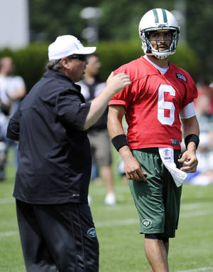 Photo - New York Jets quarterback Mark Sanchez (6) looks on as offensive coordinator Marty Mornhinweg talks  during NFL football practice Wednesday, June 5, 2013, in Florham Park, N.J. (AP Photo/Bill Kostroun)