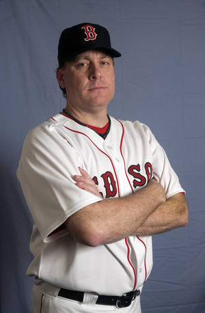 Photo - FILE - This is a Feb. 24, 2008 file photo showing Boston Red Sox baseball player Curt Schiling. Former major league pitcher Curt Schilling says he's battling mouth cancer and blames 30 years of chewing tobacco use. Schilling discussed details of his cancer on WEEI-FM in Boston on Wednesday, Aug. 20, 2014. (AP Photo/Steven Senne, File)