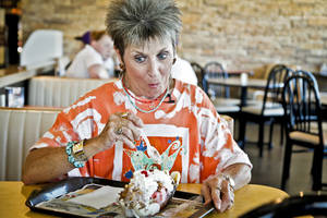 photo - Patti Dobelbower reacts after trying her very first banana split at Braum's. <strong>CHRIS LANDSBERGER - THE OKLAHOMAN</strong>