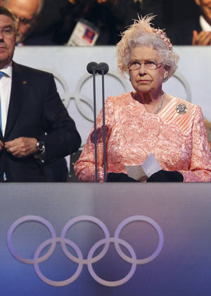 Photo -   Britain's Queen Elizabeth II declares the games open during the Opening Ceremony at the 2012 Summer Olympics, Saturday, July 28, 2012, in London. (AP Photo/Cameron Spencer, Pool)