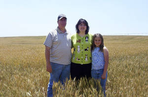 Photo - Jeff, Karen and Brittany Krehbiel are shown in a wheat field in 2005.  Jeff battled brain cancer and died in 2011.  <strong>Photo Provided - THE OKLAHOMAN, Archives</strong>