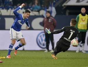 photo - Schalke's Ciprian Marica of Romania, left, scores against Hannover goalkeeper Ron-Robert Zieler, right, during the German first division Bundesliga soccer match between FC Schalke 04 and Hannover 96 in Gelsenkirchen, Germany, Friday, Jan. 18, 2013. (AP Photo/Martin Meissner)