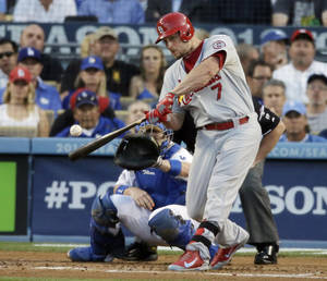 Photo - St. Louis Cardinals' Matt Holliday hits a two-run home run during the third inning of Game 4 of the National League baseball championship series against the Los Angeles Dodgers Tuesday, Oct. 15, 2013, in Los Angeles. (AP Photo/Chris Carlson)