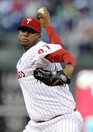 Photo - Philadelphia Phillies starting pitcher Roberto Hernandez delivers in the first inning of a baseball game against the Milwaukee Brewers, Wednesday, April 9, 2014, in Philadelphia. (AP Photo/Michael Perez)