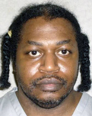 Photo - This June 29, 2011 photo provided by the Oklahoma Department of Corrections shows Charles Warner. Warner is one of is one of two Oklahoma death row inmates scheduled to be executed next month who have sued state corrections officials, Wednesday, Feb. 26, 2014 to obtain details about the lethal drugs that will be used to execute them, including their source. (AP Photo/Oklahoma Department of Corrections)