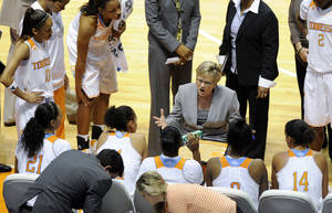Photo - Tennessee head coach Holly Warlick, center,  gives last minute instructions during a time out in the second half of an NCAA college basketball game against Lipscomb Sunday, Dec. 29, 2013, in Knoxville, Tenn. (AP Photo/Pat Murphy-Racey)