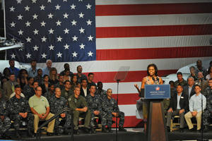 Photo - First Lady Michelle Obama visits the Mayport Naval Station in Jacksonville, Fla., on Wednesday to announce that 2,000 businesses around the country have hired or trained more than 125,000 military veterans and spouses in the past year. AP Photo <strong>Bob Mack</strong>