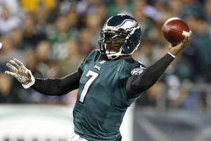 photo - FILE - In this Nov. 11, 2012 file photo, Philadelphia Eagles quarterback Michael Vick throws a pass against the Dallas Cowboys in the first half of an NFL football game in Philadelphia. Vick, who was slated to earn $16 million next season, has agreed to a restructured deal with the Philadelphia Eagles. Vick, who was injured and inconsistent last season, eventually giving way to rookie Nick Foles, now has a three-year contract, and will compete with Foles to see who runs new coach Chip Kelly's offense this season. (AP Photo/Julio Cortez, File)