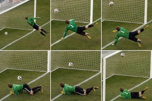 Photo - FILE - In this June 27, 2010 file photo made from a combination of six photos, Germany's goalkeeper Manuel Neuer looks at a ball that hit the bar to bounce over the line during the soccer World Cup second round soccer match between Germany and England at Free State Stadium, in Bloemfontein, South Africa. On this day: the future use of goal-line technology was effectively sealed after a clear Frank Lampard goal was not given. Germany went on to win the game 4-1. (AP Photo/Alessandra Tarantino, File)