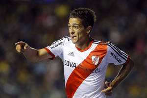 Photo - River Plate's Manuel Lanzini celebrates after scoring against Boca Juniors during an Argentine league soccer match in Buenos Aires, Argentina, Sunday, March 30, 2014. (AP Photo/Victor R. Caivano)