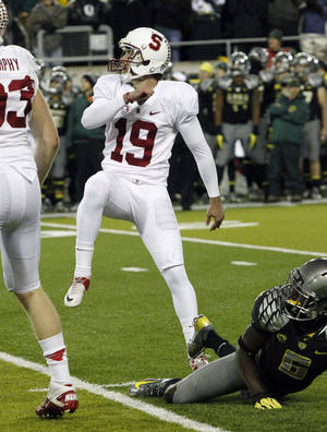 Photo -   Stanford kicker Jordan Williamson (19) watches his kick go through the uprights to win their NCAA college football game against Oregon in overtime 17-14.in Eugene, Ore., Saturday, Nov. 17, 2012.(AP Photo/Don Ryan)