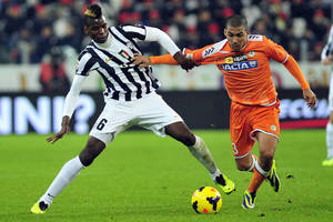 Photo - Juventus Paul Pogba, of France, left, challenges for the ball with Udinese' Marques Allan, of Brazil, during a Serie A soccer match between Juventus and Udinese at the Juventus stadium, in Turin, Italy, Sunday, Dec. 1, 2013. (AP Photo/Massimo Pinca)