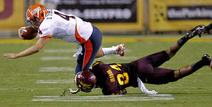 photo -   Illinois quarterback Reilly O'Toole (4) is tackled by Arizona State cornerback Osahon Irabor (24) second half of an NCAA college football game, Saturday, Sept. 8, 2012,in Tempe, Ariz. (AP Photo/Matt York)