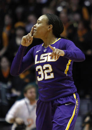 Photo - LSU guard Danielle Ballard (32) quiets fans after an NCAA college basketball game against Tennessee on Thursday, Jan. 2, 2014, in Knoxville, Tenn. LSU won 80-77. (AP Photo/Wade Payne)