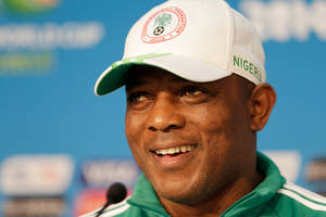 Photo - Nigeria coach Stephen Keshi smiles during a news conference prior to a training session at the Arena Pantanal in Cuiaba, Brazil, Friday, June 20, 2014. Nigeria plays in group F of the 2014 soccer World Cup. (AP Photo/Fernando Llano)