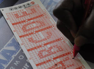 Photo -   A customer fills in his numbers on a Powerball ticket for a chance to win the $450,000 jackpot Monday, Nov. 26, 2012, in Houston for a chance to win the $450,000 jackpot. (AP Photo/Pat Sullivan)