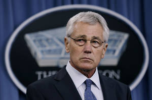 Photo -  Defense Secretary Chuck Hagel listens Monday during a news conference at the Pentagon where he recommended shrinking the Army to its smallest size since the buildup to U.S. involvement in World War II in an effort to balance postwar defense needs with budget realities. AP Photo  <strong>Carolyn Kaster -   </strong>