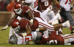 Photo - Oklahoma's Matthew Romar (92) and Chuka Ndulue (98) bring down Texas Tech's DeAndre Washington (21) during a college football game between the University of Oklahoma Sooners (OU) and the Texas Tech Red Raiders at Gaylord Family-Oklahoma Memorial Stadium in Norman, Okla., on Saturday, Oct. 26, 2013. Oklahoma won 38-30. Photo by Bryan Terry, The Oklahoman