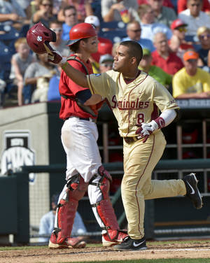 Photo -   Florida State's Devon Travis (8) runs past Stony Brook catcher Pat Cantwell after hitting a two-run home run in the fourth inning of an NCAA College World Series elimination baseball game in Omaha, Neb., Sunday, June 17, 2012. (AP Photo/Ted Kirk)
