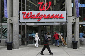 "Photo - This June 4, 2014 photo shows a Walgreens retail store in Boston. Walgreen Co. _ which bills itself as ""America's premier pharmacy"" _  is among many companies considering combining operations with foreign businesses to trim their tax bills. These deals, called inversions, have raised concerns among some U.S. lawmakers over the potential for lost tax revenue. (AP Photo/Charles Krupa)"