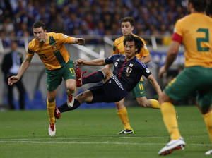 Photo - FILE - In this June 4, 2013, file photo, Japan's Shinji Okazaki, center, tries to score during their Asian zone Group B qualifying soccer match against Australia for the 2014 World Cup in Saitama, near Tokyo.  (AP Photo/Shuji Kajiyama, File) - SEE FURTHER WORLD CUP CONTENT AT APIMAGES.COM
