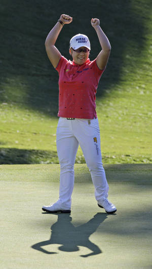 Photo -   Jiyai Shin, of South Korea, celebrates winning the Kingsmill Championship LPGA Tour golf tournament in Williamsburg, Va., Monday, Sept. 10, 2012. Shin won the tournament in a nine-hole playoff with Paula Creamer. (AP Photo/Steve Helber)