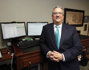 Photo - Frank Merrick is president of Foundation Management Inc. in Oklahoma City. Merriock is shown in his office on Monday. <strong>PAUL HELLSTERN - The Oklahoman</strong>