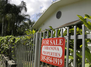 Photo - This Monday, May 19, 2014 photo shows a duplex home for sale in the Coconut Grove neighborhood in Miami. Freddie Mac releases weekly mortgage rates on Thursday, July 3, 2014. (AP Photo/Lynne Sladky)