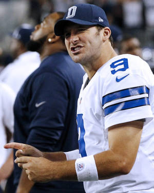 Photo - Dallas Cowboys quarterback Tony Romo (9) celebrates on the sideline during the second half of an NFL football game against the Philadelphia Eagles on Sunday, Dec. 2, 2012 in Arlington, Texas. The Cowboys won 38-33. (AP Photo/Tony Gutierrez)