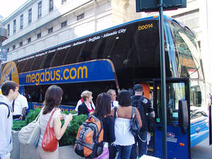 Photo - Passengers board a Megabus coach. Megabus.com now offers three trips a day between Oklahoma City and Dallas, each with a stop in Norman. Photo provided by Megabus.com