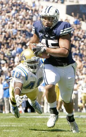 Photo - BYU running back Harvey Unga, a preseason all-conference pick, is part of an electric Cougar offense. AP PHOTO