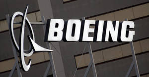Photo - FILE - The Boeing Company logo is seen on the property in El Segundo, Calif., in this Jan. 25, 2011 file photo. Boeing is expected to announce third-quarter earnings later Wednesday Oct. 23, 2013. (AP Photo/Reed Saxon, File)