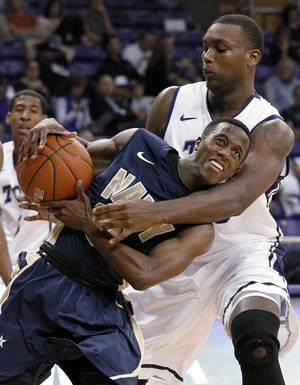 Photo -   Navy guard Tilman Dunbar (10) is wrapped up going to the basket by TCU 's Devonta Abron, right, in the first half of an NCAA college basketball game Tuesday, Nov. 20, 2012, in Fort Worth, Texas. (AP Photo/Tony Gutierrez)