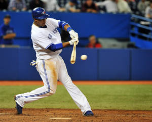 Photo -   Toronto Blue Jays' Yunel Escobar hits a ground out against the Baltimore Orioles during the ninth inning of a baseball game in Toronto, Tuesday, Sept. 4, 2012. (AP Photo/The Canadian Press, Aaron Vincent Elkaim)