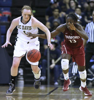 Photo - Stanford forward Chiney Ogwumike, right, steals a pass from UC Davis forward Heidi Johnson during the first half of an NCAA college basketball game, Friday, Nov. 30, 2012, in Davis, Calif. (AP Photo/Rich Pedroncelli)
