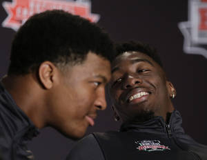 Photo - Florida State wide receiver Kenny Shaw, right, looks over at quarterback Jameis Winston during a news conference on Friday, Jan. 3, 2014 in Newport Beach, Calif. Florida State is scheduled to play Auburn on Monday, in the BCS national championship NCAA college football game. (AP Photo/Chris Carlson)