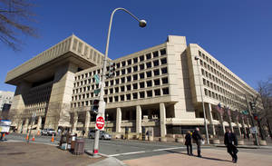 "Photo - FILE - This Feb. 3, 2012 file photo shows Federal Bureau of Investigation (FBI) headquarters in Washington. Just six blocks from the White House, the FBI's hulking headquarters overlooking Pennsylvania Avenue has long been the government building everyone loves to hate. The verdict: it's an ugly, crumbling concrete behemoth. An architectural mishap, all 2.4 million square feet of it. But in this time of tight budgets, massive deficits and the ""fiscal cliff,"" the 38-year-old FBI headquarters building has one big thing in its favor. It sits atop very valuable real estate, an entire city block on American's Main Street midway between the U.S. Capitol and the White House. Just how valuable, the General Services Administration intends to find out. (AP Photo/Manuel Balce Ceneta, File)"