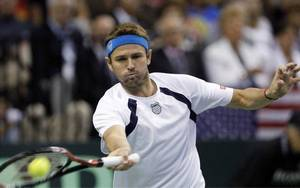 Photo - United States' Mardy Fish returns the ball to David Ferrer, of Spain, during their Davis Cup tennis quarterfinal match Sunday, July 10, 2011, in Austin, Texas. (AP Photo/Eric Gay) <strong>Eric Gay</strong>