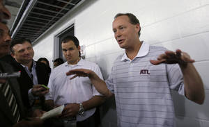 Photo - Atlanta Hawks coach Mike Budenholzer gestures as he talks to reporters before the Hawks' NBA preseason basketball game against the Miami Heat, Monday, Oct. 7, 2013, in Miami. (AP Photo/Alan Diaz)