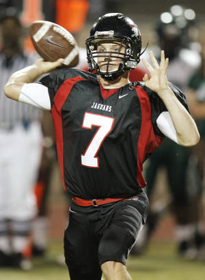 Photo - Trevor Thompson passes for Westmoore during a 2010 game. Thompson threw for nearly 1,200 yards last season.  Photo by Nate Billings, The Oklahoman Archive
