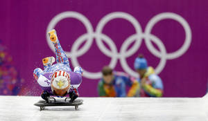 Photo - Katie Uhlaender of the United States starts a training run for the women's skeleton during the 2014 Winter Olympics, Monday, Feb. 10, 2014, in Krasnaya Polyana, Russia. (AP Photo/Natacha Pisarenko)