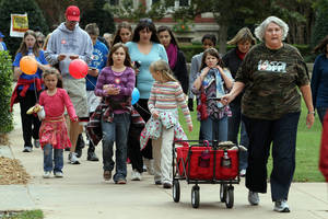 Photo - Participants in Sunday's Cleveland County CROP Walk to Stop Hunger cross the University of Oklahoma campus.  PHOTO BY HUGH SCOTT,  FOR THE OKLAHOMAN
