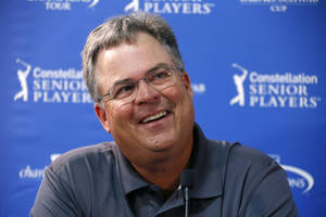 Photo - Kenny Perry, last year's winner at the Senior Players Championship golf tournament, talks with reporters before playing in a Pro-Am at Fox Chapel Golf Club in Pittsburgh, Wednesday, June 25, 2014. Tournament play begins Thursday. (AP Photo/Gene J. Puskar)